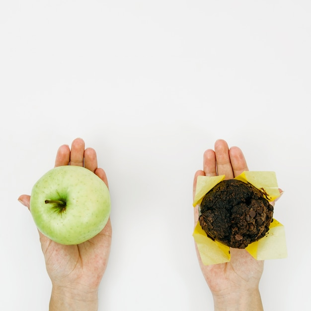 Top view apple vs muffin Free Photo