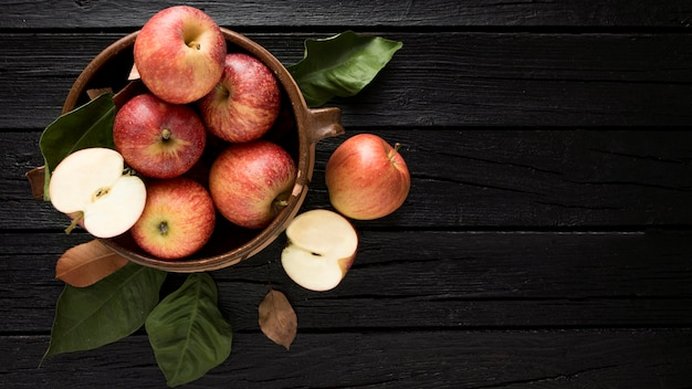 Top view of apples in basket with copy space Premium Photo