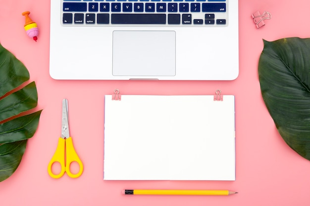 Top view arrangement of desk elements on pink background Free Photo
