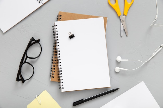 Top view arrangement of desk elements with empty notebook Free Photo