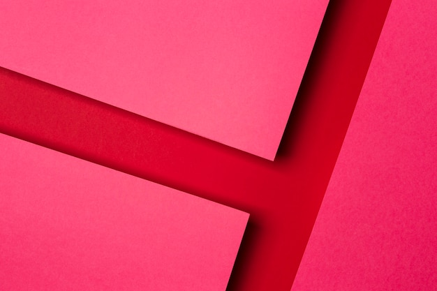 Top view arrangement of red paper sheets background Free Photo