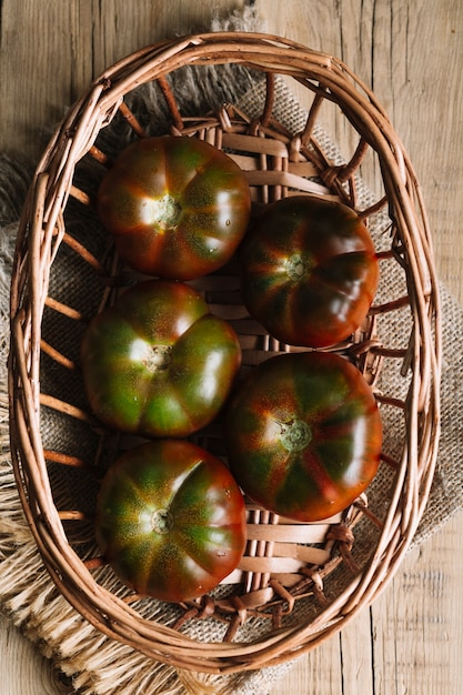Top view arrangement of tomatoes in a bowl Free Photo