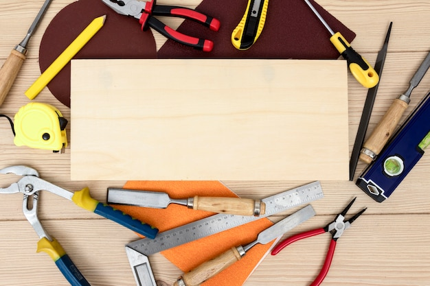 Top view arrangement of tools for carpentry copy space Premium Photo