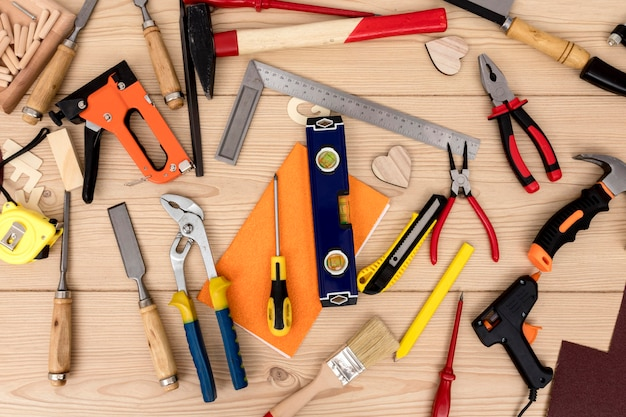 Top view arrangement of tools for carpentry Premium Photo