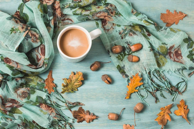 Top view arrangement with autumn leaves and coffee Free Photo