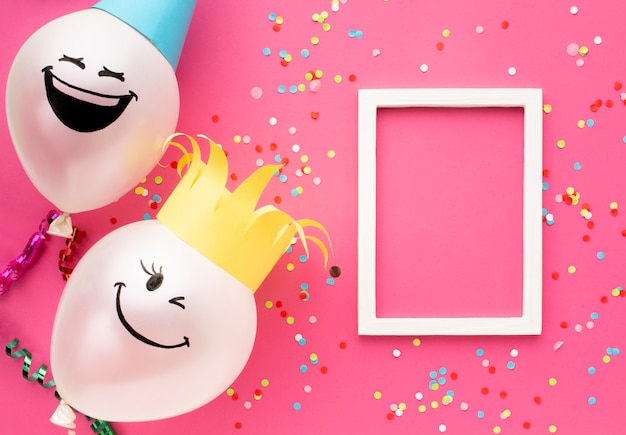 Top view arrangement with balloons and frame Free Photo