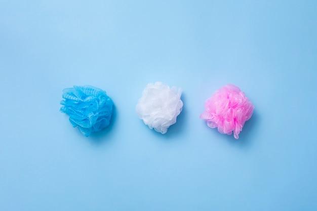 Top view arrangement with bath sponges on blue background Free Photo