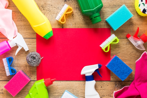 Top view arrangement with cleaning products and wooden background Free Photo