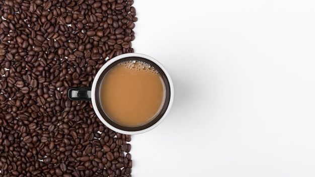 Top view arrangement with coffee cup and beans Free Photo