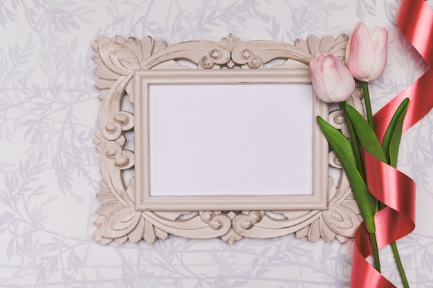 Top view arrangement with frame and tulips Free Photo