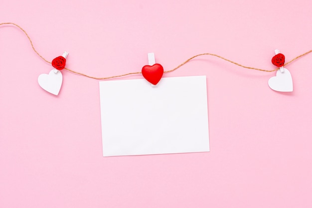 Top view arrangement with hearts and piece of paper Free Photo