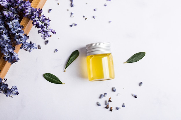 Top view arrangement with honey bottle and flower Free Photo