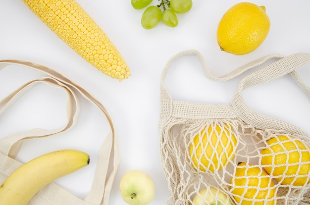 Top view arrangement with lemons and corn Free Photo