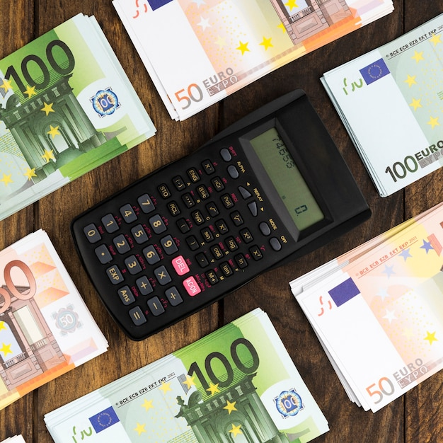 Top view arrangement with money and pocket calculator Free Photo