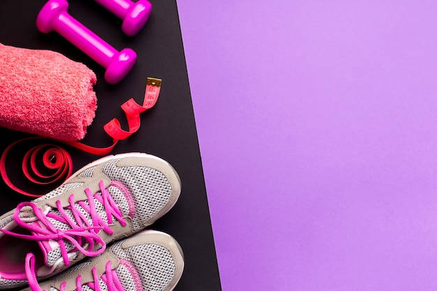 Top view arrangement with running shoes and towel Free Photo