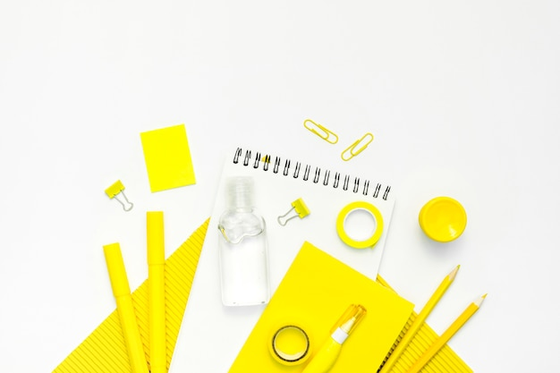 Top view arrangement with school items Free Photo
