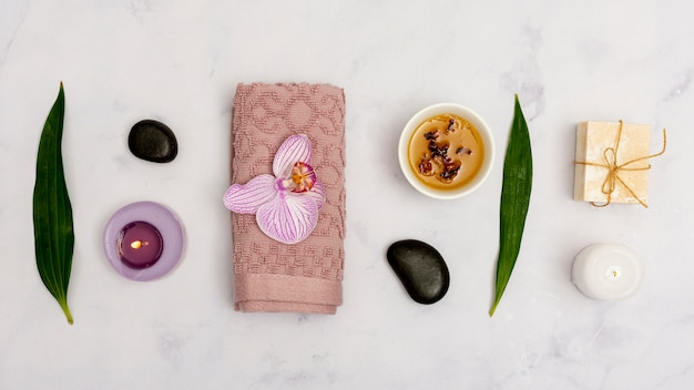Top view arrangement with spa products on marble table Free Photo
