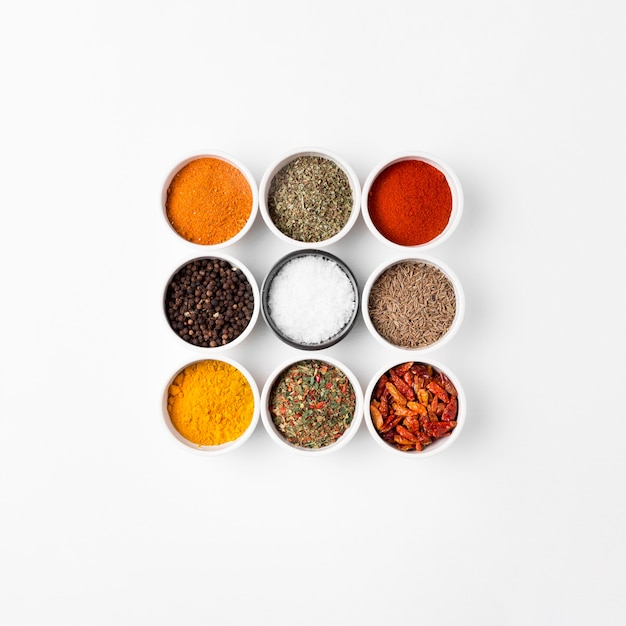 Top view arrangement with spices in bowls Premium Photo