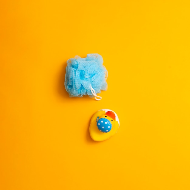 Top view arrangement with sponge and toy Free Photo
