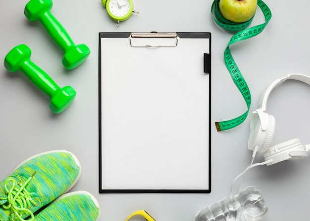 Top view arrangement with sports attributes and clipboard Free Photo