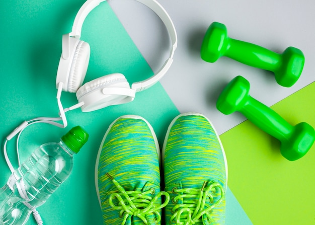 Top view arrangement with sports equipment and headphones Free Photo