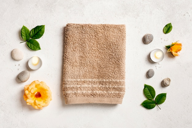 Top view arrangement with towel and candles Free Photo