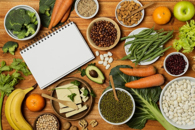 Top view arrangement with vegetables and notebook mock-up Free Photo