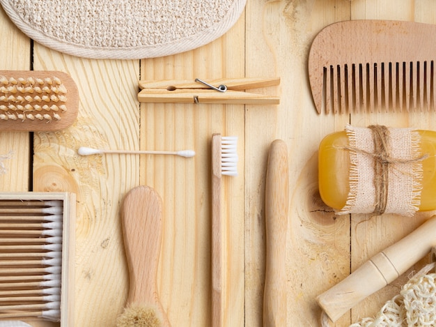Top view arrangement with wooden care products Free Photo