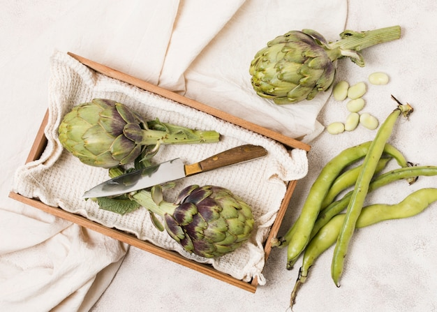 Top view of artichokes and beans Free Photo