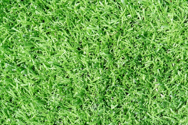 Top view artificial grass soccer field  background texture Free Photo