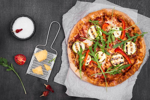 Top view arugula pizza with cheese Free Photo