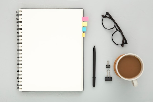 Top view assortment of desk elements on grey background Free Photo