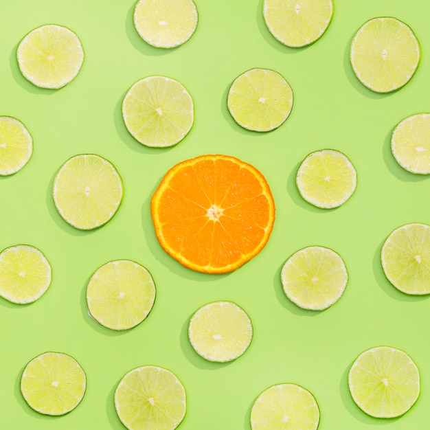 Top view assortment of organic lime and orange slice Free Photo