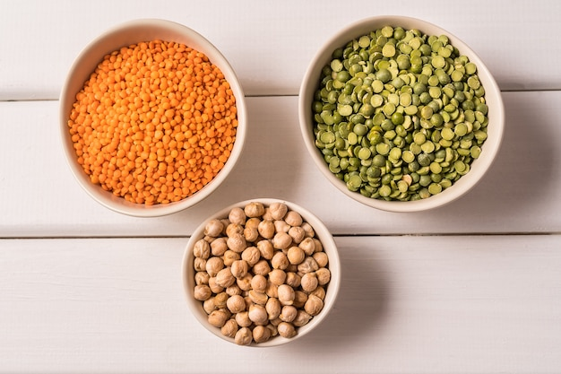 Top view of assortment of peas, lentils, beans and legumes on white Premium Photo