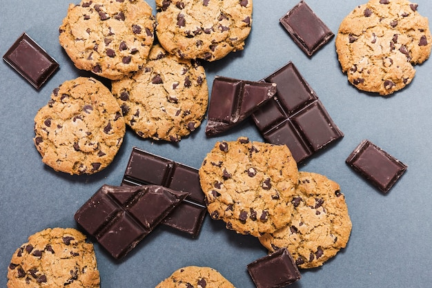 Top view assortment with cookies and dark chocolate Free Photo