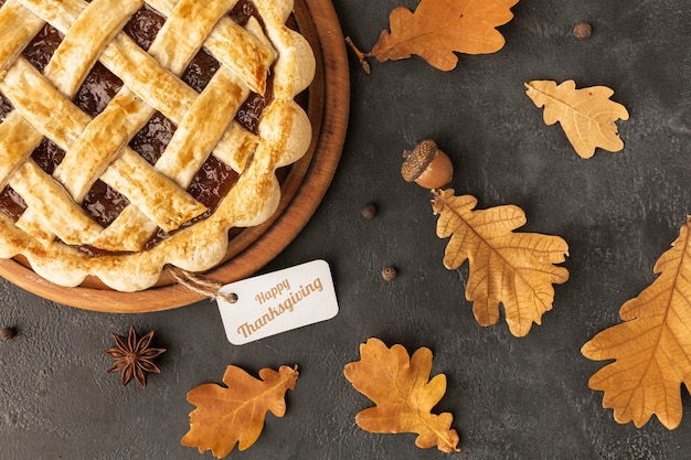 Top view assortment with delicious pie and leaves Free Photo
