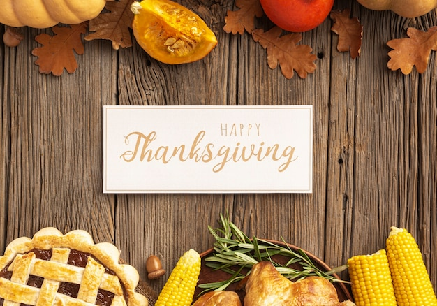 Top view assortment with pumpkins and thanksgiving sign Free Photo