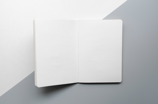 Top view assortment with white notebook Free Photo