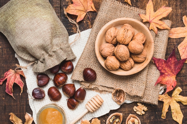 Top view autumn arrangement with nuts and honey Free Photo