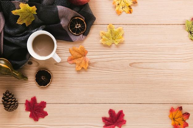 Top view autumn arrangement on wooden background Free Photo