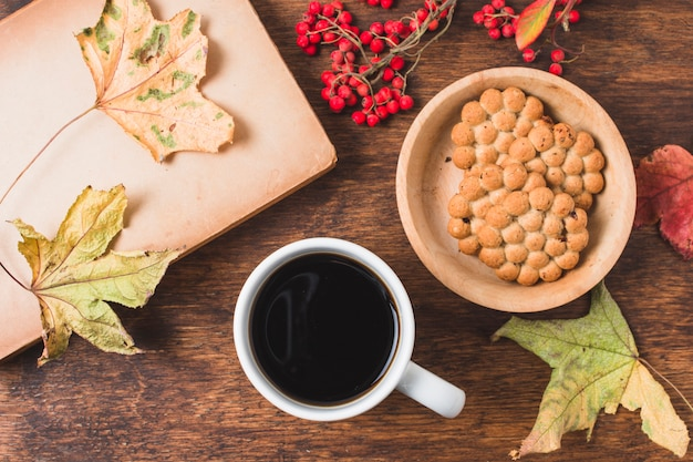 Top view autumn composition with coffee and cookies Free Photo