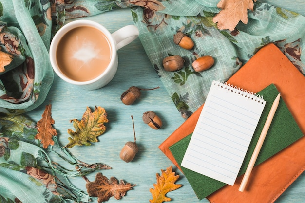 Top view autumn composition with coffee and notebooks Free Photo