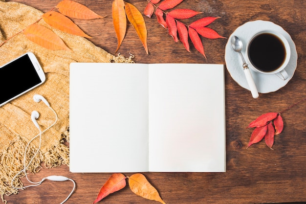 Top view autumn composition with opened notebook Free Photo