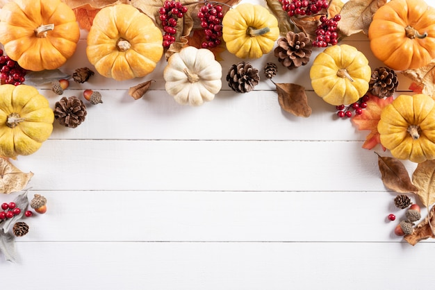Top view of autumn decoration on wooden. thanksgiving day concept. Premium Photo