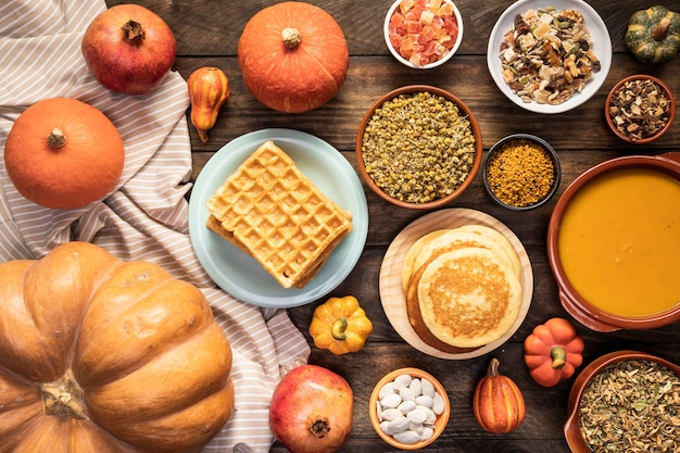 Top view autumn food on sheet and wooden background Free Photo