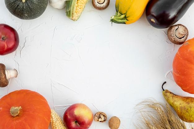 Top view autumn fruits and vegetables with copy space Free Photo