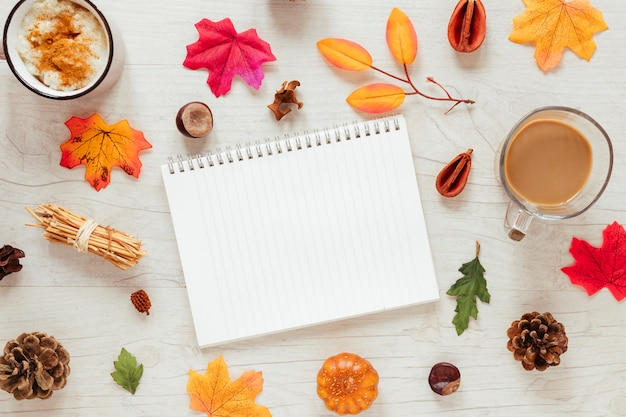 Top view autumn leaves with a notebook Free Photo