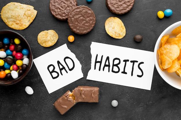 Top view bad habit with snacks Free Photo