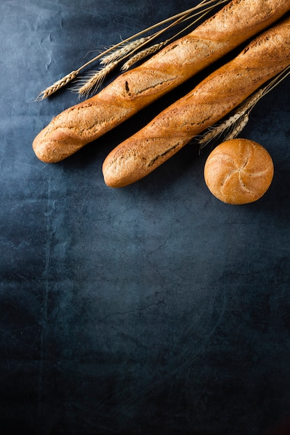 Top view of baguette on black background wirh copy space Free Photo