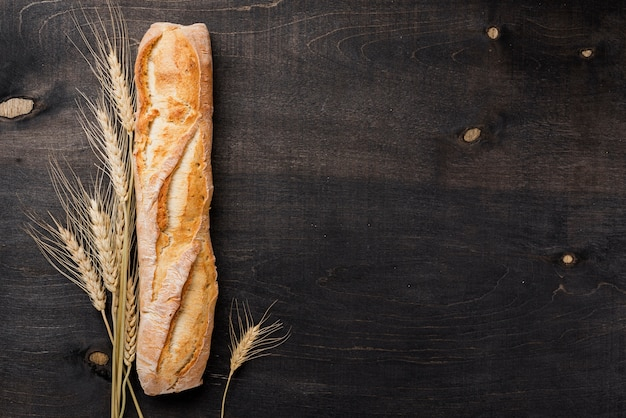 Top view baguette french bread with wheat and copy space Premium Photo